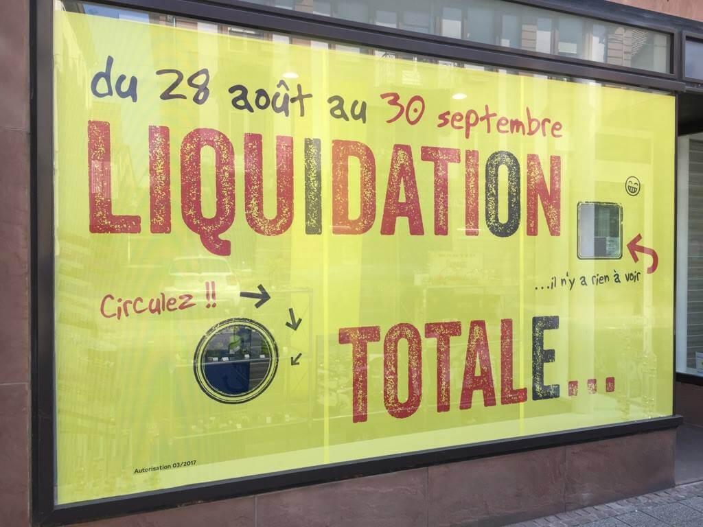 """Top départ pour la """"Liquidation Totale"""": Schneider Optique et Surdité à Wissembourg Conception, impression et pose de l'habillage des vitrines"""